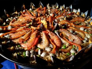 A Paella Cooking Class in Barcelona - Tasty Homemade Paella covered in prawns
